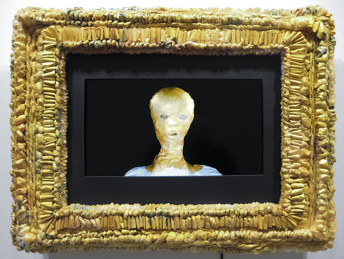 Elina Katara | Frutti di mare | 2016 | video/animation, television screen, golden frame made out of domestic plastic waste and golden acrylic paint.